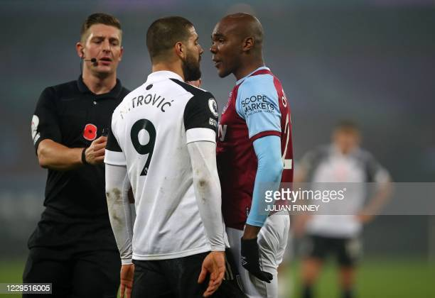 West Ham United's Italian defender Angelo Ogbonna and Fulham's Serbian striker Aleksandar Mitrovic have a disagreement as the Referee Robert Jones...