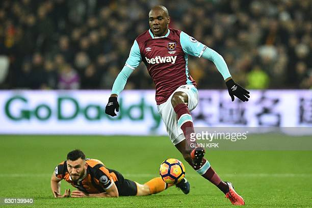 West Ham United's Italian defender Angelo Ogbonna runs with the ball away from Hull City's Scottish midfielder Robert Snodgrass during the English...
