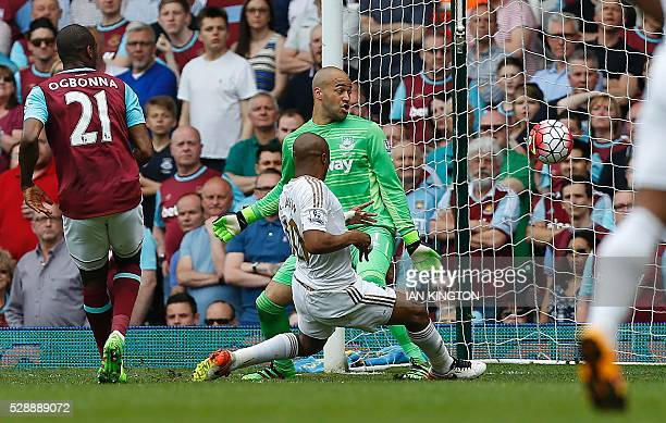 West Ham United's Italian defender Angelo Ogbonna watches as Swansea City's Ghanaian striker Andre Ayew shoots past West Ham United's Irish...