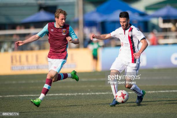 West Ham United's Jaanai Gordon competes with Cagliari Calcio's Andrea Cadili for a ball during their Main Tournament Shield Final match part of the...