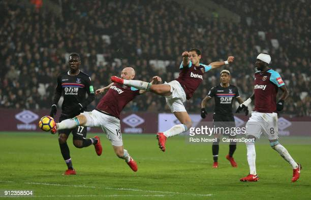 West Ham United's James Collins and Javier Hernandez just fail to connect with a cross during the Premier League match between West Ham United and...