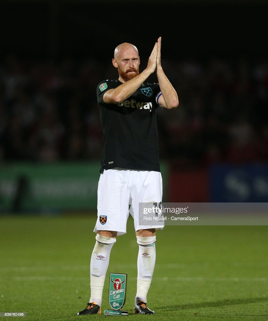 West Ham United's James Collins applauds the West Ham fans at the end of the game during the Carabao Cup Second Round match between Cheltenham Town and West Ham United at Whaddon Road on August 23, 2017 in Cheltenham, England.