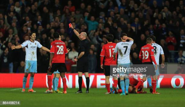 West Ham United's James Tomkins is sent off by referee Lee Mason during the Barclays Premier League match at Cardiff City Stadium Cardiff/ Picture...