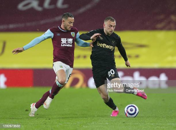 West Ham United's Jarrod Bowen and Burnley's Josh Brownhill during the Premier League match between Burnley and West Ham United at Turf Moor on May...
