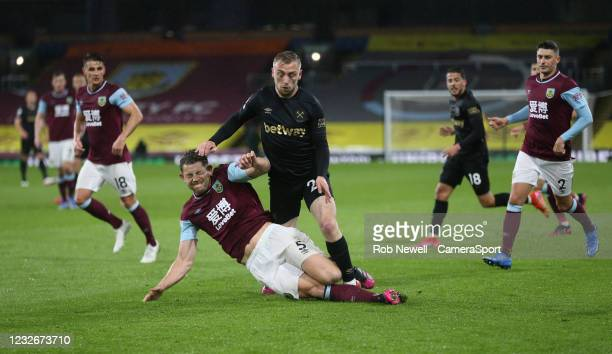 West Ham United's Jarrod Bowen is challenged by Burnley's James Tarkowski during the Premier League match between Burnley and West Ham United at Turf...