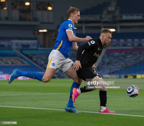 West Ham United's Jarrod Bowen under pressure from Brighton & Hove Albion's Dan Burn during the Premier League match between Brighton & Hove Albion...