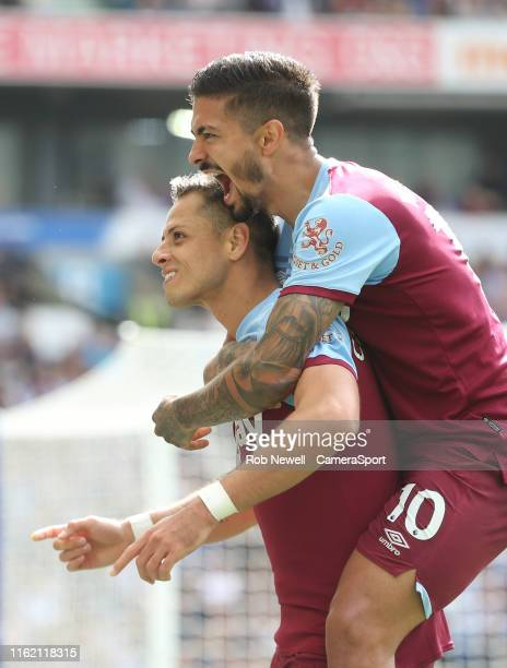 West Ham United's Javier Hernandez celebrates scoring his side's first goal with Manuel Lanzini during the Premier League match between Brighton Hove...