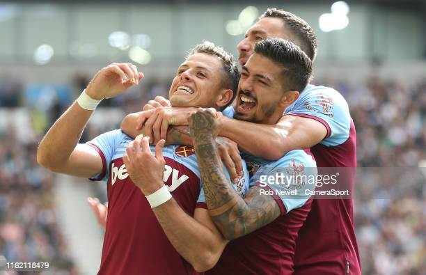 West Ham United's Javier Hernandez celebrates scoring his side's first goal with Manuel Lanzini and Robert Snodgrass during the Premier League match...