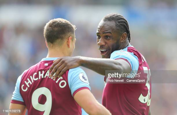 West Ham United's Javier Hernandez celebrates scoring his side's first goal with Michail Antonio during the Premier League match between Brighton...