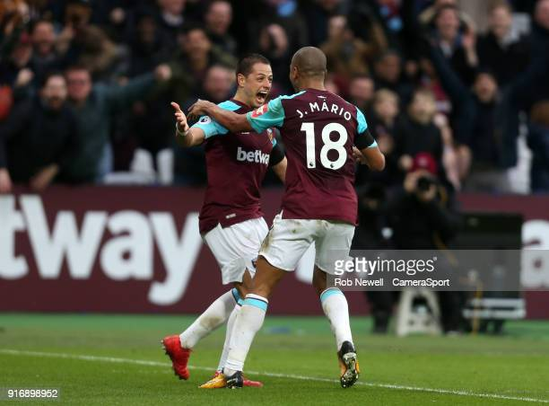 West Ham United's Javier Hernandez celebrates scoring his side's first goal with Joao Mario during the Premier League match between West Ham United...