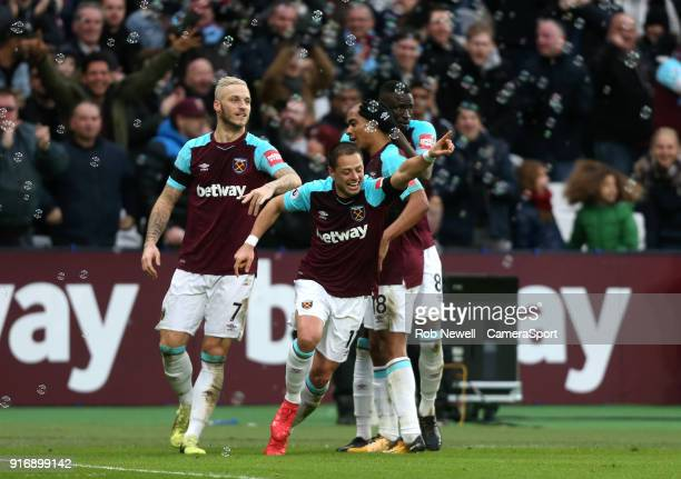 West Ham United's Javier Hernandez celebrates scoring his side's first goal during the Premier League match between West Ham United and Watford at...
