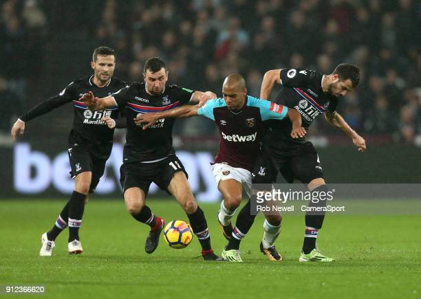 West Ham United's Joao Mario gets in between Crystal Palace's James McArthur Yohan Cabaye and Luka Milivojevic during the Premier League match...