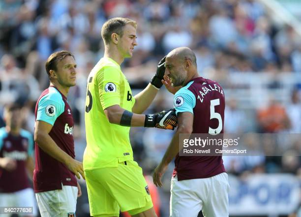 West Ham United's Joe Hart inspects the cut on Pablo Zabaleta's head during the Premier League match between Newcastle United and West Ham United at...