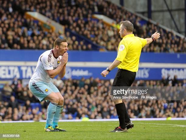 West Ham United's Kevin Nolan appeals to match referee Jon Moss