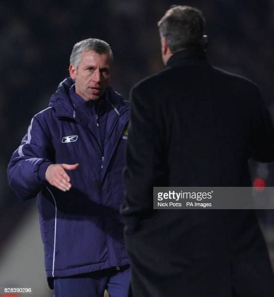 West Ham United's Manager Alan Pardew shakes hand with Bolton Wanderers manager Sam Allardyce after their 21 extra time victory in the FA Cup fifth...