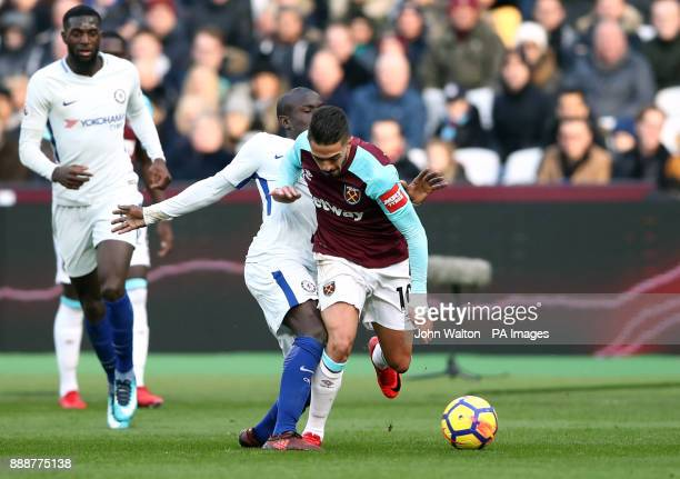 West Ham United's Manuel Lanzini and Chelsea's Ngolo Kante during the Premier League match at the London Stadium