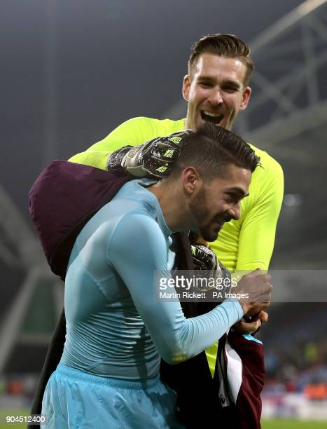 West Ham United's Manuel Lanzini and goalkeeper Adrian celebrate after the final whistle during the Premier League match at the John Smith's Stadium...