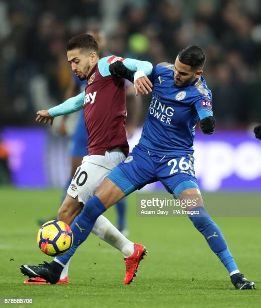 West Ham United's Manuel Lanzini and Leicester City's Riyad Mahrez battle for the ball during the Premier League match at the London Stadium