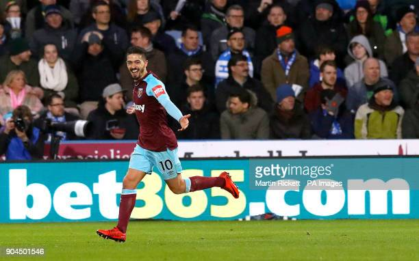 West Ham United's Manuel Lanzini celebrates scoring his side's fourth goal of the game during the Premier League match at the John Smith's Stadium...