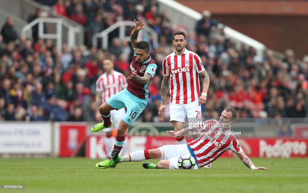West Ham United's Manuel Lanzini is challenged by Stoke City's Glenn Whelan during the Premier League match between Stoke City and West Ham United at Bet365 Stadium on April 29, 2017 in Stoke on Trent, England.