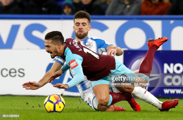 West Ham United's Manuel Lanzini reacts to a challenge from Huddersfield Town's Tommy Smith during the Premier League match at the John Smith's...