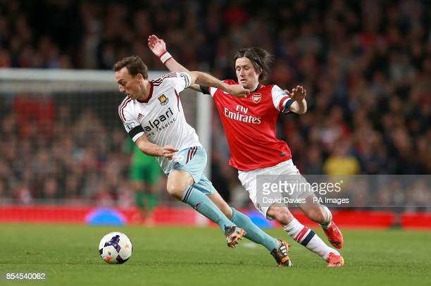 West Ham United's Mark Noble and Arsenal's Tomas Rosicky battle for the ball