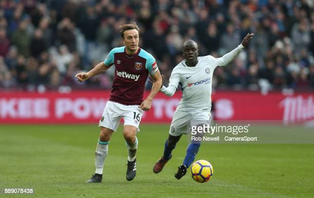 West Ham United's Mark Noble and Chelsea's Ngolo Kante during the Premier League match between West Ham United and Chelsea at London Stadium on...