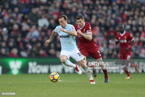 West Ham United's Mark Noble and Liverpool's James Milner during the Premier League match between Liverpool and West Ham United at Anfield on...