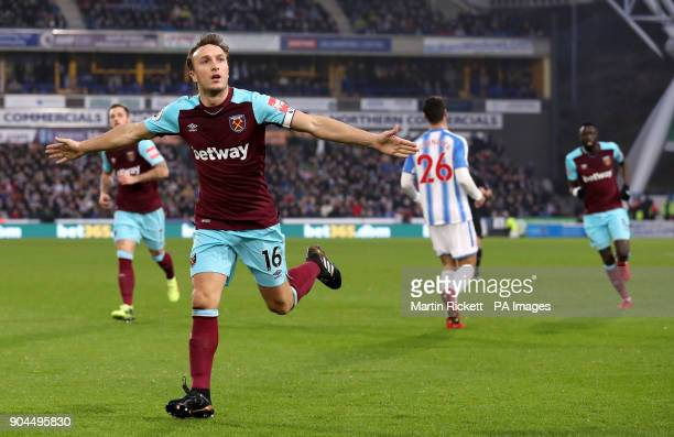West Ham United's Mark Noble celebrates scoring his side's first goal of the game during the Premier League match at the John Smith's Stadium...