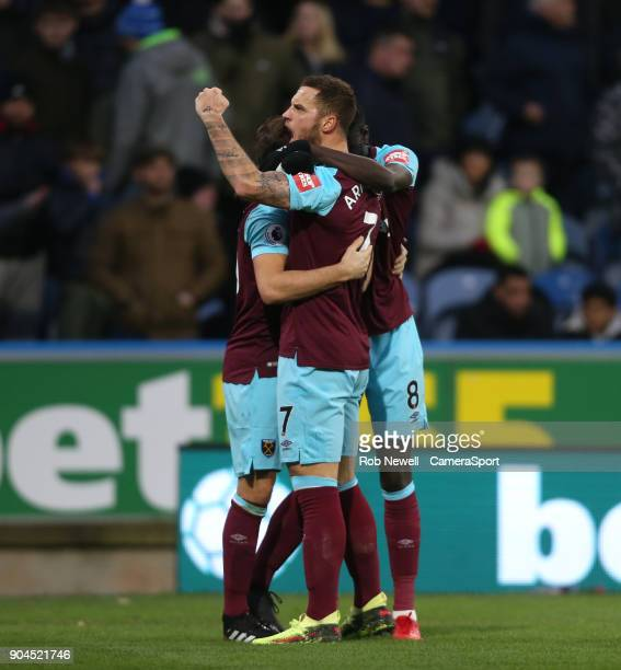 West Ham United's Mark Noble celebrates scoring his side's first goal with Marko Arnautovic and Cheikhou Kouyate during the Premier League match...