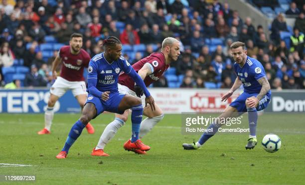 West Ham United's Marko Arnautovic and Cardiff City's Leandro Bacuna during the Premier League match between Cardiff City and West Ham United at...