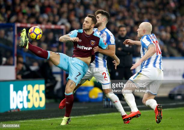 West Ham United's Marko Arnautovic and Huddersfield Town's Tommy Smith battle for the ball during the Premier League match at the John Smith's...