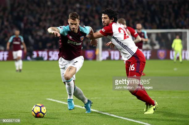 West Ham United's Marko Arnautovic and West Bromwich Albion's Ahmed Hegazy battle for the ball during the Premier League match at London Stadium
