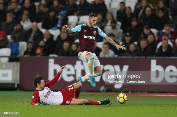 West Ham United's Marko Arnautovic and West Bromwich Albion's Grzegorz Krychowiak during the Premier League match between West Ham United and West...