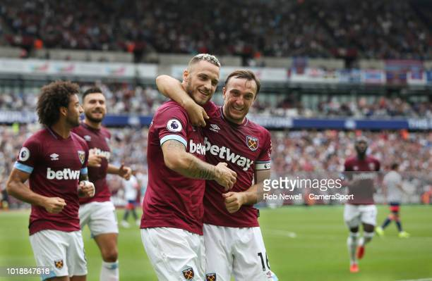 West Ham United's Marko Arnautovic celebrates scoring his side's first goal with Mark Noble during the Premier League match between West Ham United...