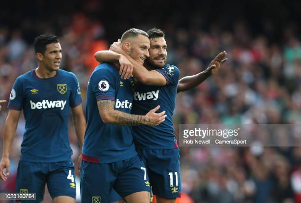 West Ham United's Marko Arnautovic celebrates scoring his side's first goal with Robert Snodgrass during the Premier League match between Arsenal FC...