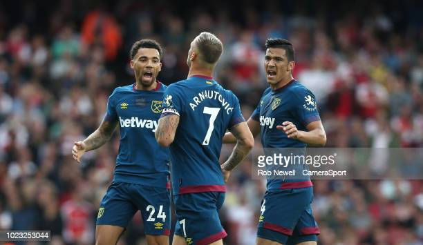 West Ham United's Marko Arnautovic celebrates scoring his side's first goal with Ryan Fredericks and Fabian Balbuena during the Premier League match...