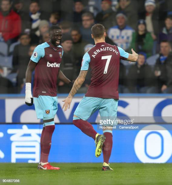 West Ham United's Marko Arnautovic celebrates scoring his side's second goal with Cheikhou Kouyate during the Premier League match between...
