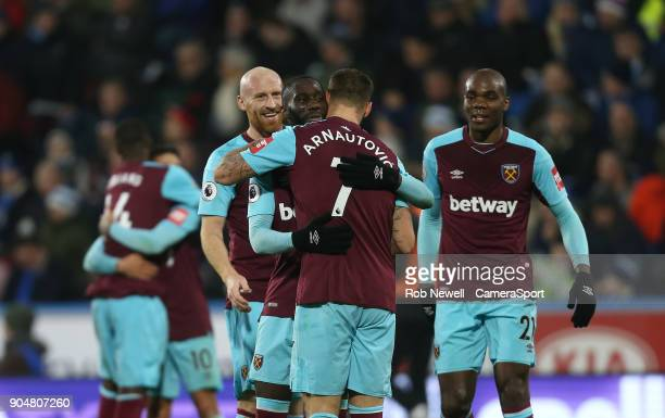 West Ham United's Marko Arnautovic celebrates with Arthur Masuaku during the Premier League match between Huddersfield Town and West Ham United at...