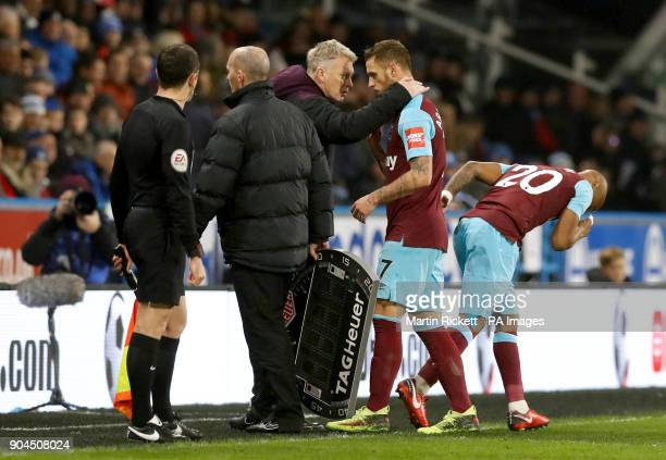 West Ham United's Marko Arnautovic is substituted for team mate Andre Ayew during the Premier League match at the John Smith's Stadium Huddersfield
