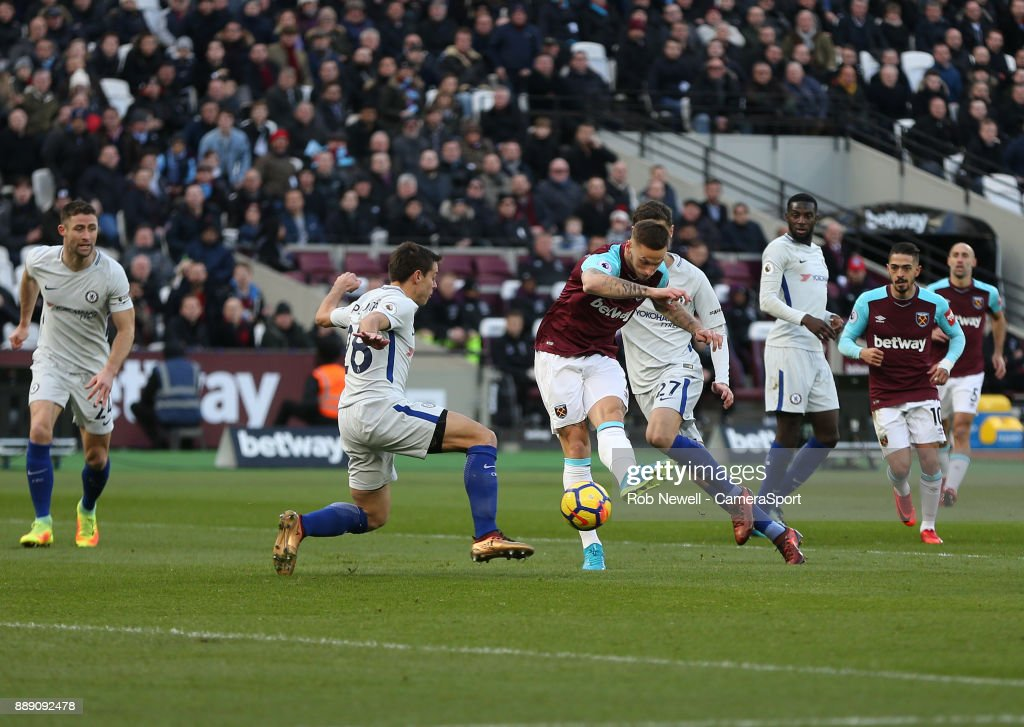 West Ham United's Marko Arnautovic scores his side's first goal during the Premier League match between West Ham United and Chelsea at London Stadium on December 9, 2017 in London, England.