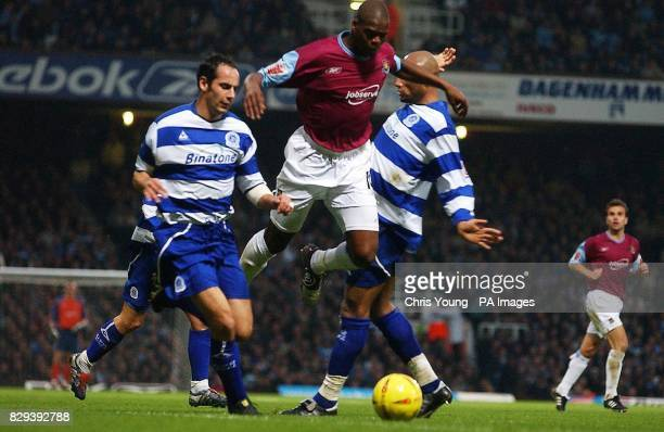 West Ham United's Marlon Harewood gets past Queens Park Rangers' Matthew Rose and Georges Santos during the CocaCola Championship match at Upton Park...