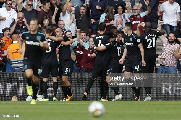 West Ham United's Mexican striker Javier Hernandez celebrates with teammates scoring the team's second goal during the English Premier League...