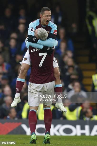 West Ham United's Mexican striker Javier Hernandez celebrates with West Ham United's Austrian midfielder Marko Arnautovic after scoring their first...