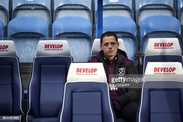 West Ham United's Mexican striker Javier Hernandez is seen on the substitutes bench during the English Premier League football match between...