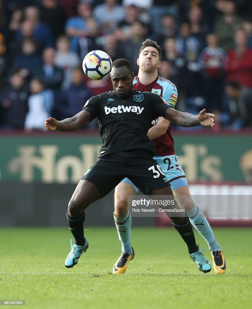 West Ham United's Michail Antonio and Burnley's Stephen Ward during the Premier League match between Burnley and West Ham United at Turf Moor on October 14, 2017 in Burnley, England.