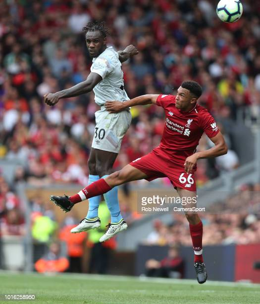 West Ham United's Michail Antonio and Liverpool's Trent AlexanderArnold during the Premier League match between Liverpool FC and West Ham United at...