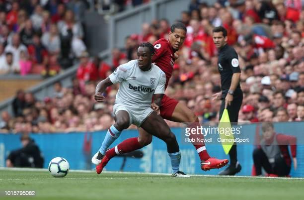 West Ham United's Michail Antonio and Liverpool's Virgil van Dijk during the Premier League match between Liverpool FC and West Ham United at Anfield...
