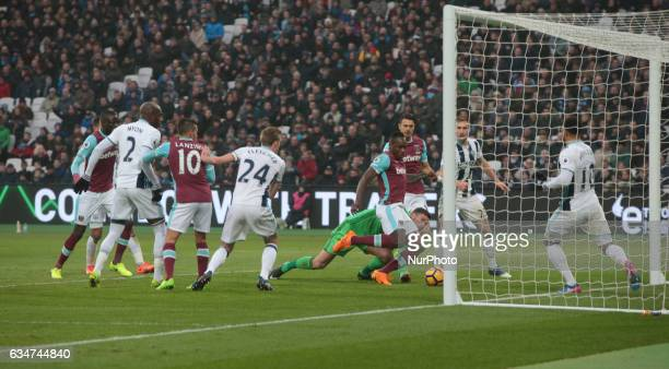 West Ham United's Michail Antonio and West Bromwich Albion's Ben Foster during EPL Premier League match between West Ham United against West Bromwich...
