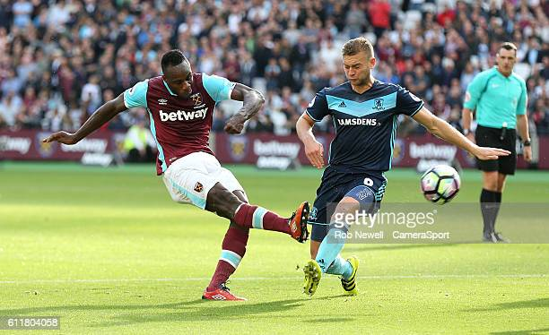 West Ham United's Michail Antonio gets in a shot under pressure from Middlesbrough's Ben Gibson during the Premier League match between West Ham...
